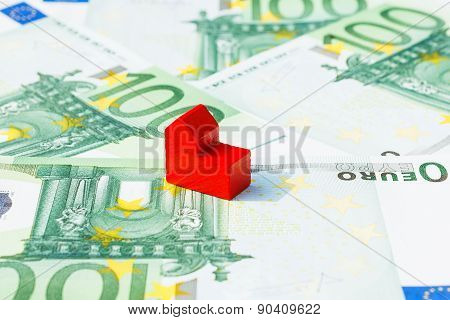 Concept church sell loan debt bill on hundred euro banknotes. Focus on red church. poster
