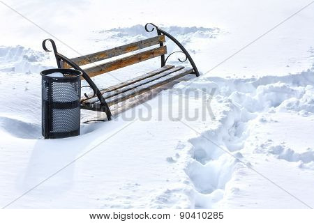 Lonely Bench In Winter Snow Covered Park