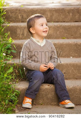 beautiful happy baby boy with blowball, outdoors shoot
