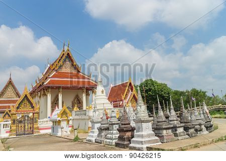place of worship with sky background at Wat Khun Thip poster