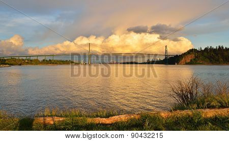 Lions Gate Bridge And Downtown Vancouver With Spectacular Clouds At Sunset