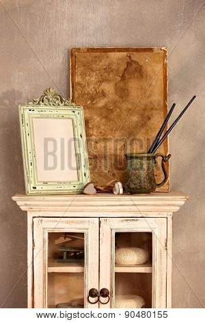 Vintage style home interior with show-case, frame and painting tools.