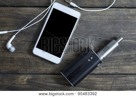 E-cigarette And Phone On Table