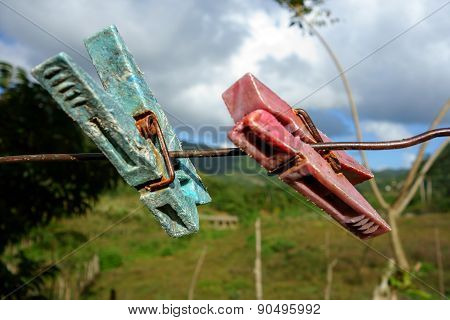 Two aged clothespin as friends on a clothes line