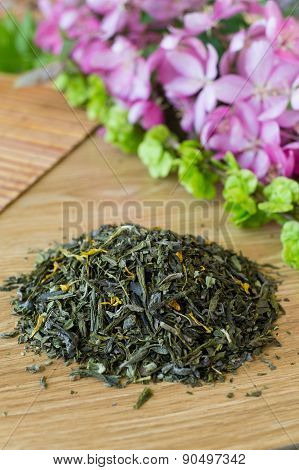 Blend Of Green Tea On A Table With Colours.