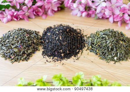 Three Found Teas On A Table.