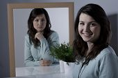 Lonely young woman with bipolar personality disorder poster