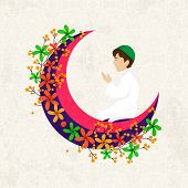 Religious Muslim young boy praying Namaz (Muslim prayer) on beautiful flowers decorated pink moon for holy month of prayers Ramadan Kareem celebrations. poster
