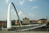 millenium bridge is a spectacular addition to the already famous roll-call of bridges across the river tyne. it cost 22 million to build and weighs over 850 tonnes. it is a footbridge between gateshead and newcastle and opens to allow ships to pass undern poster
