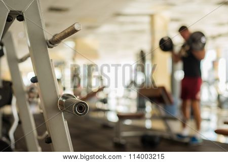 Sportsman with barbell.