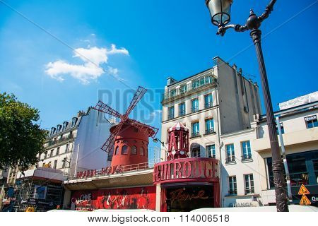 Paris - JULY 8, 2013:  Moulin Rouge Cabaret famous red mill on J