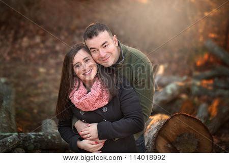 portrait of engaged couple hugging each other