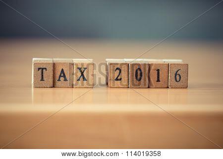 Tax 2016 Word Written On Wood Blocks, Vintage Retro Color Tone
