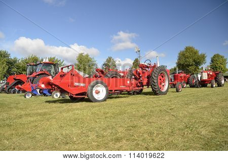 Tractors and manure spreader at a farm show