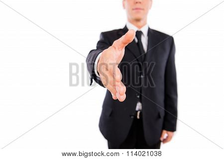 Close-up Of Man With Outstreched Hand On The White Background