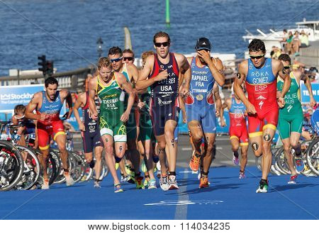 Group Of Running Triathletes Including The Leader Javier Gomez