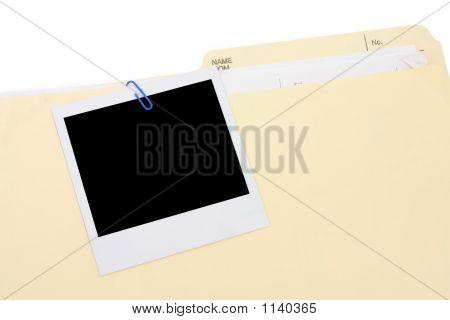 Una foto y la carpeta de archivo