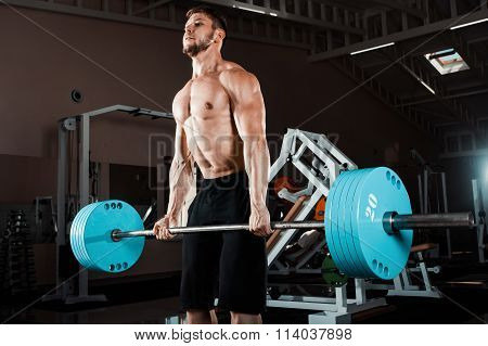 Muscular Man Lifting Deadlift