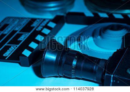 Old Retro Camera, Film Clapper, Rolls Of Film And A 35Mm Box Films
