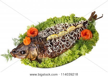 Baked sturgeon with greens and vegetables.