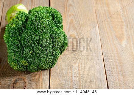 Raw fresh broccoli on wooden background