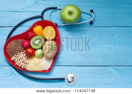 Food on heart plate with stethoscope cardiology concept