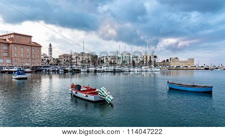 Bari, Italy - December, 30 2015: Cityscape Of Old Town And Seafront From Marina After Sunset.