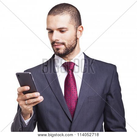 Businessman reading a message on his smartphone, isolated on white background