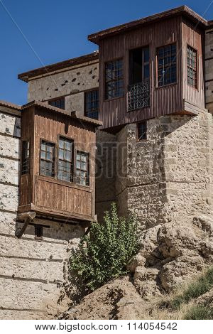 Traditional Ottoman houses with stone walls in Harput Elazig Turkey poster