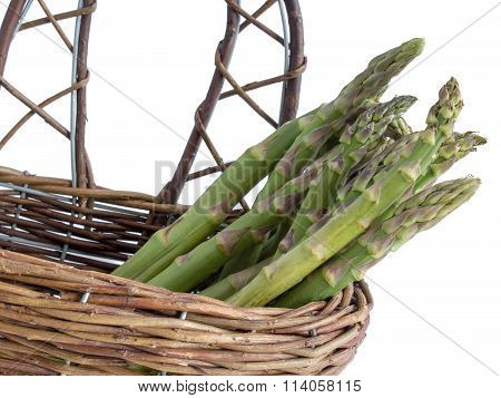 Green asparagus in a basket, isolated
