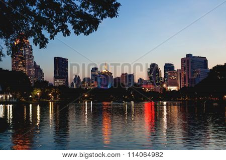 Panorama View On Bangkok From Lumpini Park. Night View Over The Lake. Bangkok, Thailand.