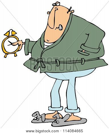 Upset man looking at alarm clock