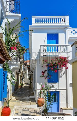 Beautiful houses on a narrow street in Skopelos old town, Greece