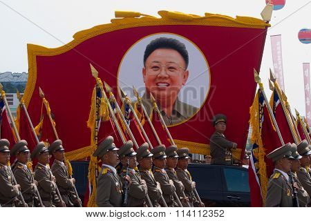 Pyongyang, North Korea. CIRCA July 2013: North Korean soldiers at the military parade in Pyongyang with the portrait of Kim Jonhg-Il of the 60th anniversary of the conclusion of the Korean War.