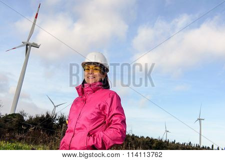 Woman Engineer Checking Wind Turbines.
