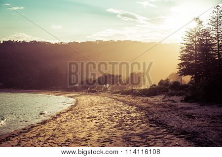 Calm Sunny Beach With Sunset In Background