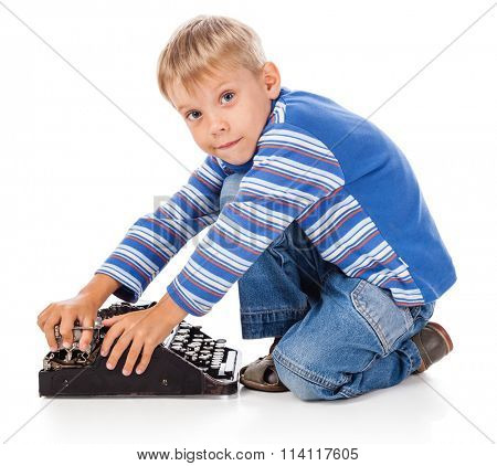 Playful Little Boy with Old Typewriter