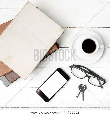 Coffee Cup With Phone,key,eyeglasses And Stack Of Book