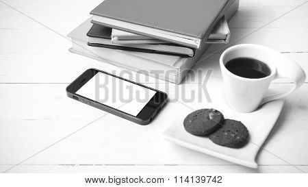 Coffe Cup With Cookie,phone And Stack Of Book Black And White Color
