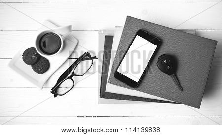 Coffe Cup With Cookie,phone,car Key,eyeglasses And Stack Of Book Black And White Color