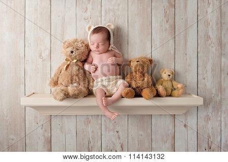 Newborn Baby Boy On A Shelf With Teddy Bears