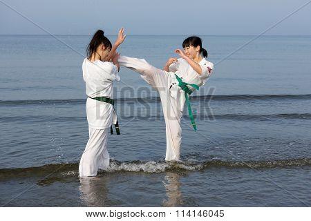 Japanese karate girls training at the beach