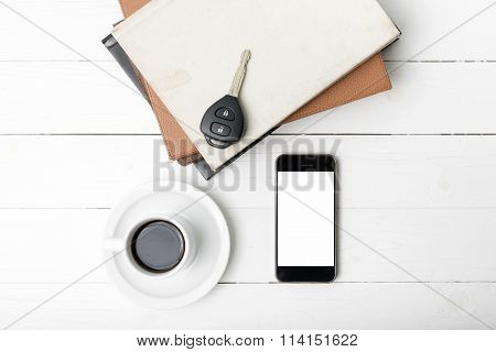 Coffee Cup With Phone,car Key And Stack Of Book