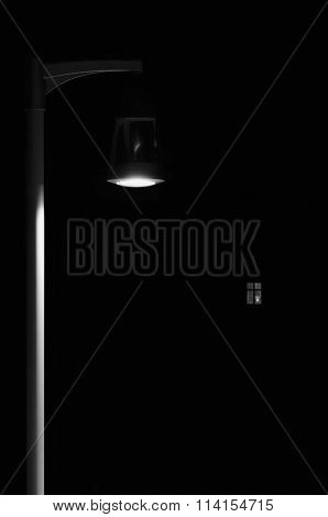 Bright Lit Outdoor Lantern Lamp Pole Post, Lonely Concept Solitude Metaphor, Illuminated Window Light, Vertical Deserted Night Park Scene Closeup, Black Isolated Copy Space Background poster