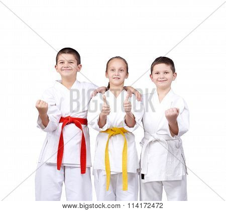 On a white background the children stand in rack and showing the finger super