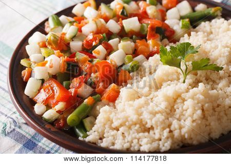 Couscous With Vegetable Salad On A Plate Macro. Horizontal