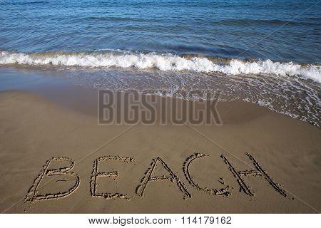 Beach Written On Wet Sand