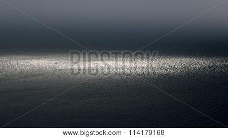Photo of spectacular dark marine seashore sea horizon with ripples fuses with grey sky at dusk bleakness over seascape background horizontal picture poster