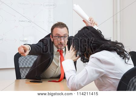Angry boss firing female colleague by showing the door with his forefinger