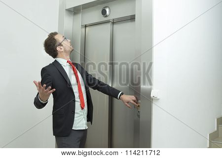 Businessman is confused because the elevator does not work